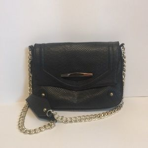 Small Black Handbag with Gold Metal Touches